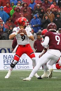Cincinnati quarterback #9 Desmond Riddler drops back to pass