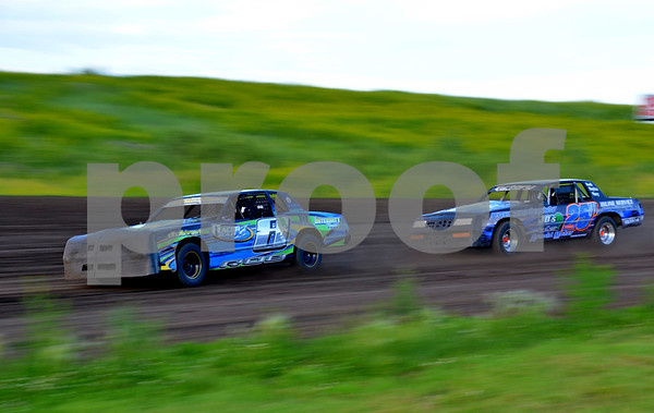 - Messenger photo by Britt Kudla<br /> (Left) Cory Roe of Webster City leads Fort Dodge's Justin Patterson around the track at the Mineral City Speedway