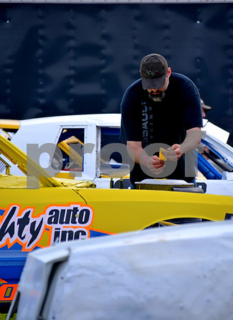 - Messenger photo by Britt Kudla<br /> Otho's Jeff Lyons prepares his car for action at the Mineral City Speedway on Sunday