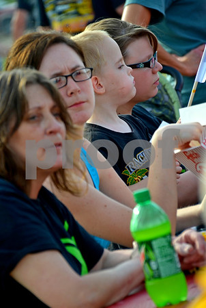- Messenger photo by Britt Kudla<br /> (Left) Lisa Patterson, Amber Patterson, Reese Cervene and Rhiannon Patterson relax and watch the races at the Mineral City Speedway on Sunday