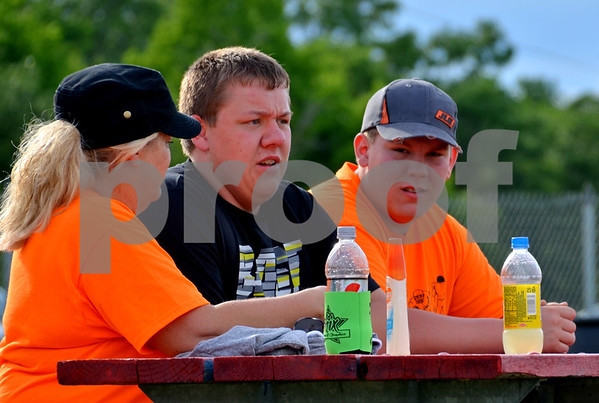 - Messenger photo by Britt Kudla<br /> (Left) Judy Cassen, Austin Hauge and Chase Almond of Fort Dodge cheer on Myles Michehl on Sunday at the Mineral City Speedway