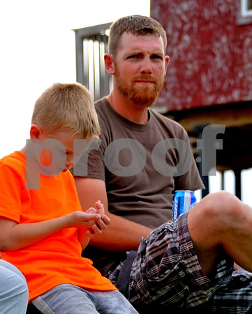 - Messenger photo by Britt Kudla<br /> Mason Lundberg (Left) enjoys a night out with his father Michael Lundberg at the Mineral City Speedway on Sunday
