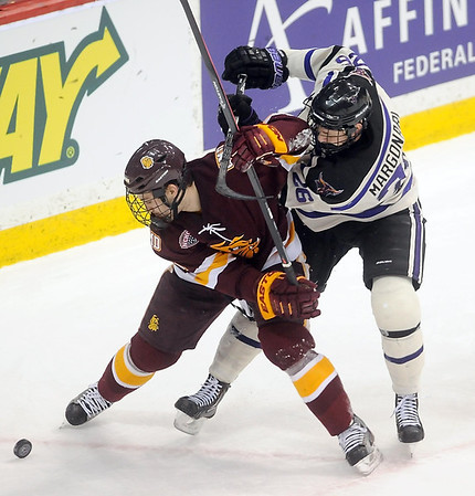 Pat Christman<br /> University of Minnesota Duluth's Derik Johnson holds off Minnesota State's Dylan Margonari during the second period Friday.
