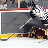 Pat Christman<br /> Minnesota State's Matt Leitner flies over the University of Minnesota Duluth's Tony Cameranesi as he reaches for the puck during the first period of their North Star College Cup game Friday at the Xcel Energy Center in St. Paul.