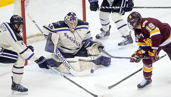 Pat Christman<br /> Minnesota State goalie Cole Huggins makes a save during the first period of their North Star College Cup game Friday at the Xcel Energy Center in St. Paul.