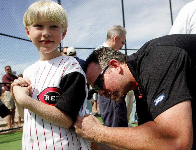 E.L. Hubbard Photography<br /> Carson Crotty, 6, has his ball shirt signed by Sean Casey during the Miracle League Park Complex of Warren County and Greater Dayton ribbon cutting and opening day at Springboro Junior High School Saturday, September 19, 2009.
