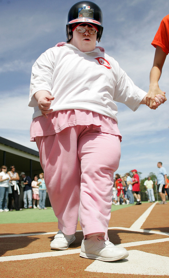 E.L. Hubbard Photography<br /> Micah Yetter, 31, holds the hand of her buddy, Hannah Griswold, as she steps on home plate during the Miracle League Park Complex of Warren County and Greater Dayton ribbon cutting and opening day at Springboro Junior High School Saturday, September 19, 2009.