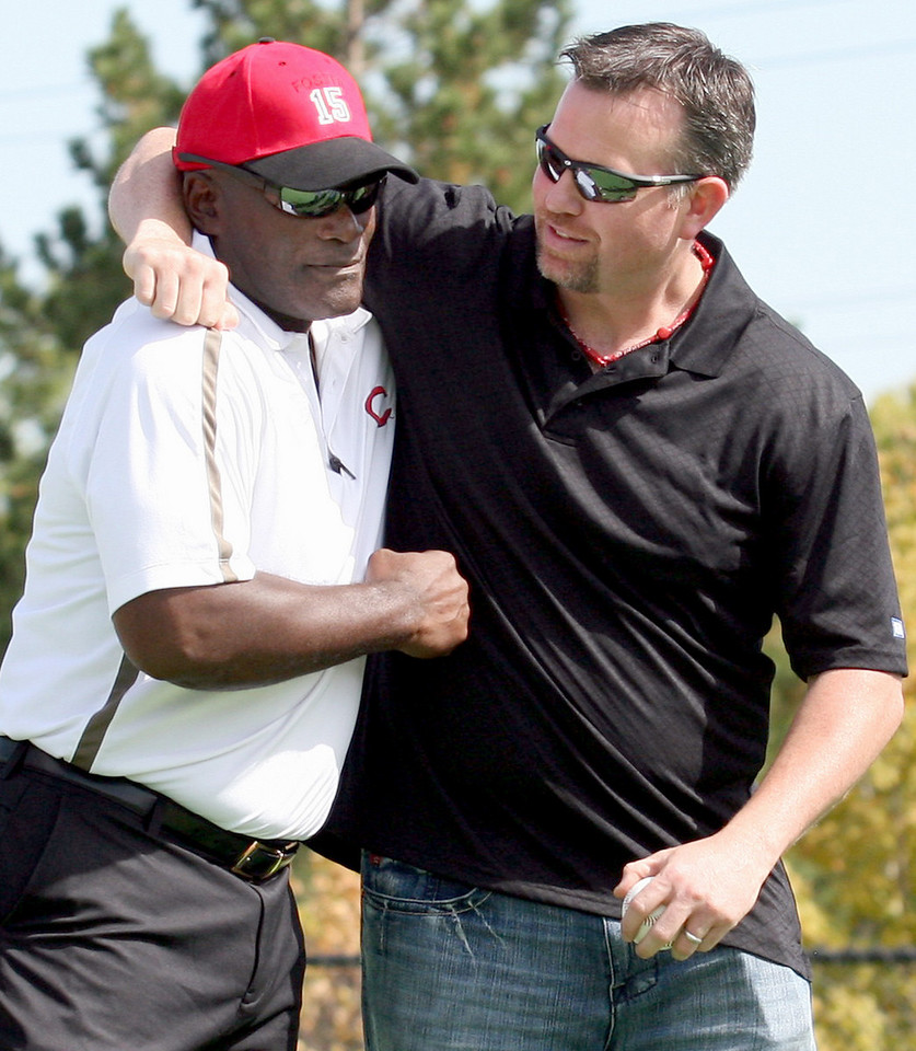 E.L. Hubbard Photography<br /> Former Reds George Foster and Sean Casey clown around togetrher during the Miracle League Park Complex of Warren County and Greater Dayton ribbon cutting and opening day at Springboro Junior High School Saturday, September 19, 2009.