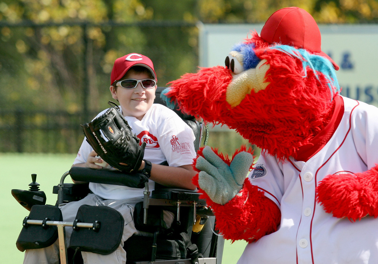 E.L. Hubbard Photography<br /> Kody Harlow, 14, gets some pointers from Gapper, the Cincinnati Reds mascot,  during the Miracle League Park Complex of Warren County and Greater Dayton ribbon cutting and opening day at Springboro Junior High School Saturday, September 19, 2009.