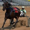 Driver Jay Cross rides Voluptuous Swan to victory in the 3-year-old filly Maple City Trot race Tuesday during harness racing at the Elkhart County 4-H Fairgrounds.