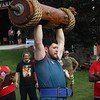 Justin Biggs competes in the log press event during the strongman competition at the 2021 Elkhart County 4-H Fair Saturday.