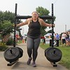 Mary Soptich competes in the yoke walk event during the strongman competition at the 2021 Elkhart County 4-H Fair Saturday.