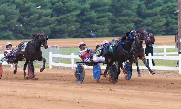 Chad Clark and Yankees Aftershock (4) lead the pack during the eighth race of 11 on Saturday at the Elkhart County 4-H Fair in Goshen. Clark and Yankees Aftershock would go on to win.