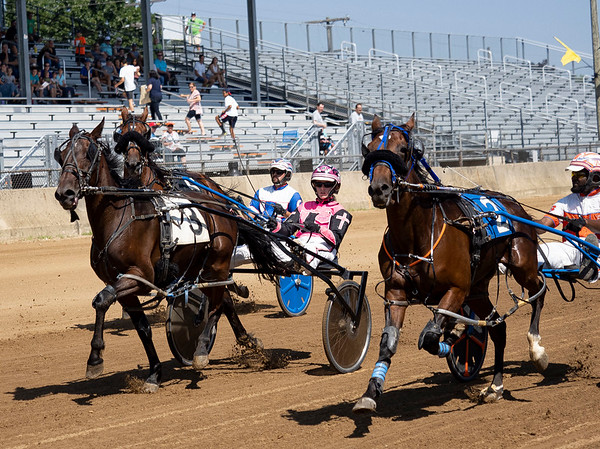 Driver Lexi Sarkine (3) drives Cornicello during race three of the one mile pace Monday during day two of harness racing at the Elkhart County 4-H Fairgrounds in Goshen.