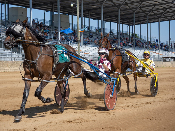 Driver Kevin Lambright (4) drives Vel Bitter Chip during race one of the one mile pace Monday during day two of harness racing at the Elkhart County 4-H Fairgrounds in Goshen.
