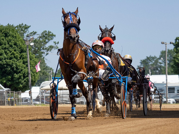 Driver Clifton Bell (2) wins the race three of the one mile pace with Luckychris Monday during day two of harness racing at the Elkhart County 4-H Fairgrounds in Goshen.
