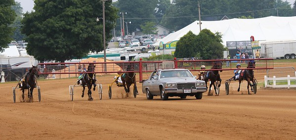 A group of harness racers near the start line before a race early on Saturday at the Elkhart County 4-H Fair in Goshen.