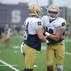 HALEY WARD | THE GOSHEN NEWS<br /> Tight end Nic Weishar 82 blocks tight end Ben Suttman (84) during Notre Dame football practice Saturday.