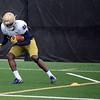 HALEY WARD | THE GOSHEN NEWS<br /> Running back Josh Adams runs drills during Notre Dame football practice Saturday.