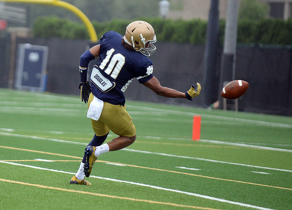HALEY WARD | THE GOSHEN NEWS<br /> Safety Max Redfield breaks up a pass during Notre Dame football practice Saturday.