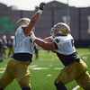 HALEY WARD | THE GOSHEN NEWS<br /> Offensive linemen Trevor Ruhland (left) and Quenton Nelson (right) practice blocking during Notre Dame football practice Wednesday.