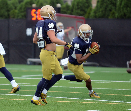 HALEY WARD | THE GOSHEN NEWS<br /> Safety Max Redfield intercepts a pass past cornerback Jesse Bongiovi during a drill at Notre Dame football practice Saturday.