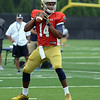 HALEY WARD | THE GOSHEN NEWS<br /> Quarterback DeShone Kizer looks to pass the ball while running drills during Notre Dame football practice Saturday.
