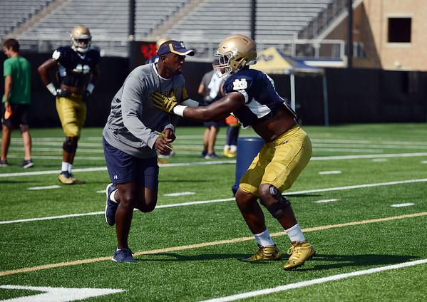 HALEY WARD | THE GOSHEN NEWS<br /> Defensive lineman Daelin Hayes practices blocking with coach during Notre Dame football practice Wednesday.