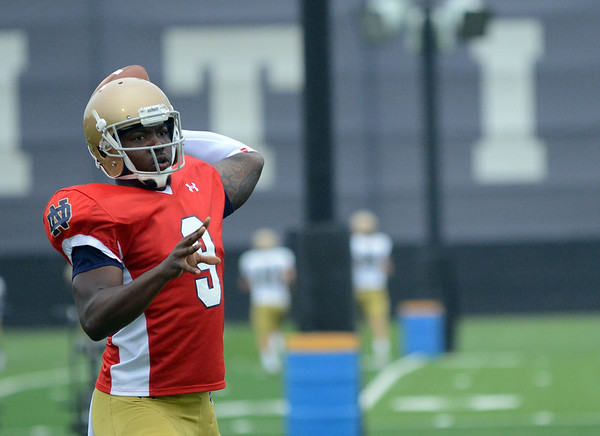HALEY WARD | THE GOSHEN NEWS<br /> Quarterback Malik Zaire passes the ball while running drills during Notre Dame football practice Saturday.