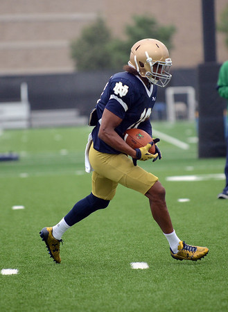HALEY WARD | THE GOSHEN NEWS<br /> Safety Max Redfield runs down the field with the ball during Notre Dame football practice Saturday.