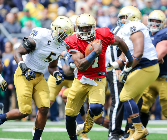 CHAD WEAVER | THE GOSHEN NEWS<br /> Notre Dame junior quarterback Brandon Wimbush breaks free on a run during the first half of Saturday's Blue-Gold Game at Notre Dame Stadium.
