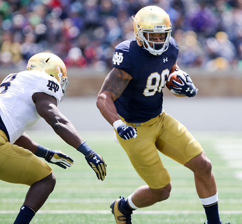 CHAD WEAVER | THE GOSHEN NEWS<br /> Notre Dame junior tight end Alize Mack runs after making a catch during the second half of Saturday's Blue-Gold Game at Notre Dame Stadium.