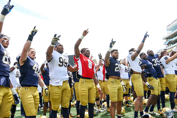 CHAD WEAVER   THE GOSHEN NEWS<br /> Notre Dame players gather for the alma mater following Saturday's Blue-Gold game at Notre Dame Stadium.