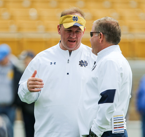 CHAD WEAVER | THE GOSHEN NEWS<br /> Notre Dame first-year defensive coordinator Mike Elko talks with head coach Brian Kelly prior to the start of Saturday's Blue-Gold game at Notre Dame Stadium.