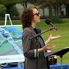 Bethany Christian Advancement Director Sarah Lind speaks to the crowd during the groundbreaking ceremony of a new athletics complex at the school Saturday.