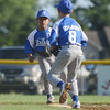 HALEY WARD | THE GOSHEN NEWS <br /> Bristol's Trevin Schlabach throws to Owen Atkinson to attempt the out during the Goshen vs. Bristol game on Friday at the Goshen Little League Park.