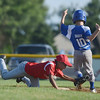 HALEY WARD | THE GOSHEN NEWS <br /> Goshen second baseman Jace Hershberger dives to tag Bristol pitcher Calvin Bailey during the Goshen vs. Bristol game on Friday at the Goshen Little League Park.