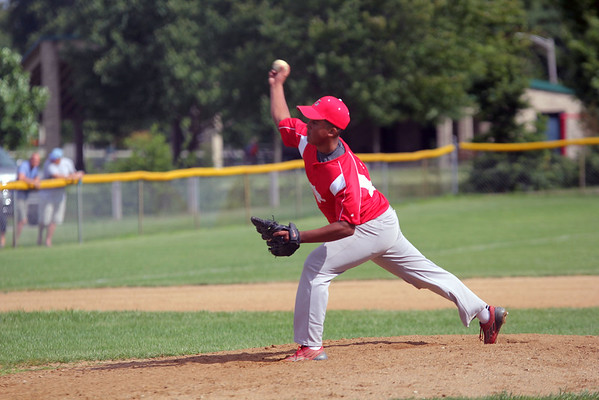 GREG KEIM | THE GOSHEN NEWS<br /> Jocsan Sanchez fires a pitch for the Goshen Juniors All-Stars in the first inning of a District 14 All-Star baseball game with Mishawaka Saturday at Goshen.