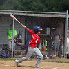 GREG KEIM | THE GOSHEN NEWS<br /> Moises Gutierrez follows through on his swing after singling for the Goshen Juniors All-Stars in the first inning of a District 14 All-Star baseball game with Mishawaka Saturday at Goshen.