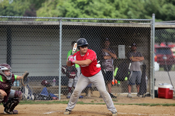 GREG KEIM | THE GOSHEN NEWS<br /> Michael Gamez eyes a pitch for the Goshen Juniors All-Stars in the first inning of a District 14 All-Star baseball game with Mishawaka Saturday at Goshen.