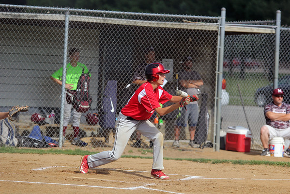 GREG KEIM | THE GOSHEN NEWS<br /> Josh Haimes of the Goshen Junior All-Stars squares to bunt in the first inning of a District 14 All-Star baseball game against Mishawaka Saturday at Goshen.