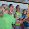 HALEY WARD | THE GOSHEN NEWS <br /> The under 12 team huddles together following their practice on Monday at Hoover Field in New Paris.