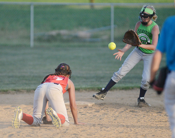 HALEY WARD | THE GOSHEN NEWS <br /> Makenna Steele throws to Kenlee Gall at second base during their practice on Monday at Hoover Field in New Paris.