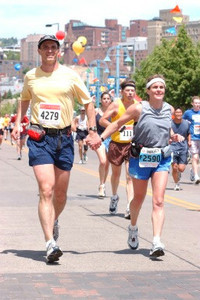 2003 Grandma's Marathon - Kris and I approaching the finish.