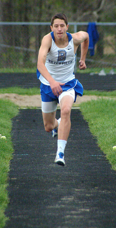 Bryan Helvie | The Herald-Tribune<br /> LONG JUMP: Batesville long jumper Tom Chaffee takes off for one of his attempts against North Decatur, Hauser and Jac-Cen-Del.