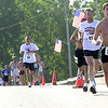 Mark Beck of Millbury, James Bighouse of Fremont, and Andy Wasserman lead over the bridge as Darrin Turner of Clyde follows ahead of a pack of runners.<br /> Photo Ben French