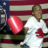 Stephon Bulger, 14, works on a punching bag.<br /> Photo Ben French