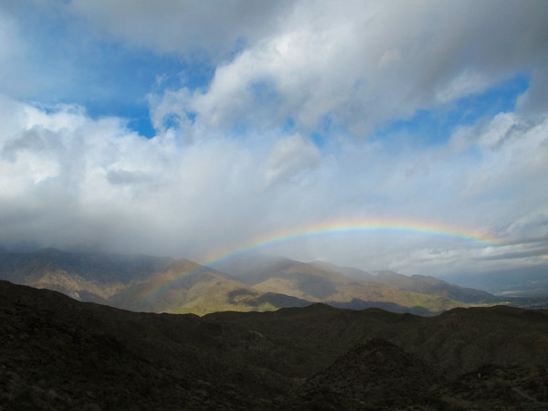 What a nice surprise this rainbow was. The rainbow end on the right is about where the windmills are.