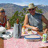 These hikers were fit. And they ate and drank well. Champagne and orange juice is chilled inside the cooler.<br /> I learned about another picnic table, a bit more secluded, beyond the obvious first two tables.