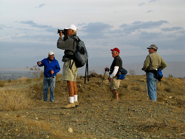 Big Horn Overlook trail-2<br /> L-R Michael, Steve, Kern and Bill taking a breather to admire a brief glimpse of sun (peaking through the clouds) allowing us to see the snow capped San Jacinto Range above Rancho Mirage.
